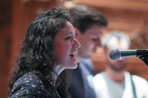 The lovely Caren '13 sings with Clint '13 and Josh '13 in the background. Photo by Alina Vorobeitchik '14.