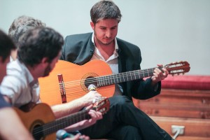 Pedro '14 plays classical guitar like the international man of mystery that he is. Photo by Alina Vorobeitchik '14.